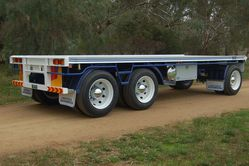 Blue Three Axle Dog Trailer